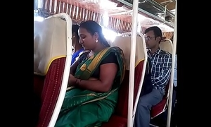 Aunty in bus.. blouse nipple visible... Watch delicately 1